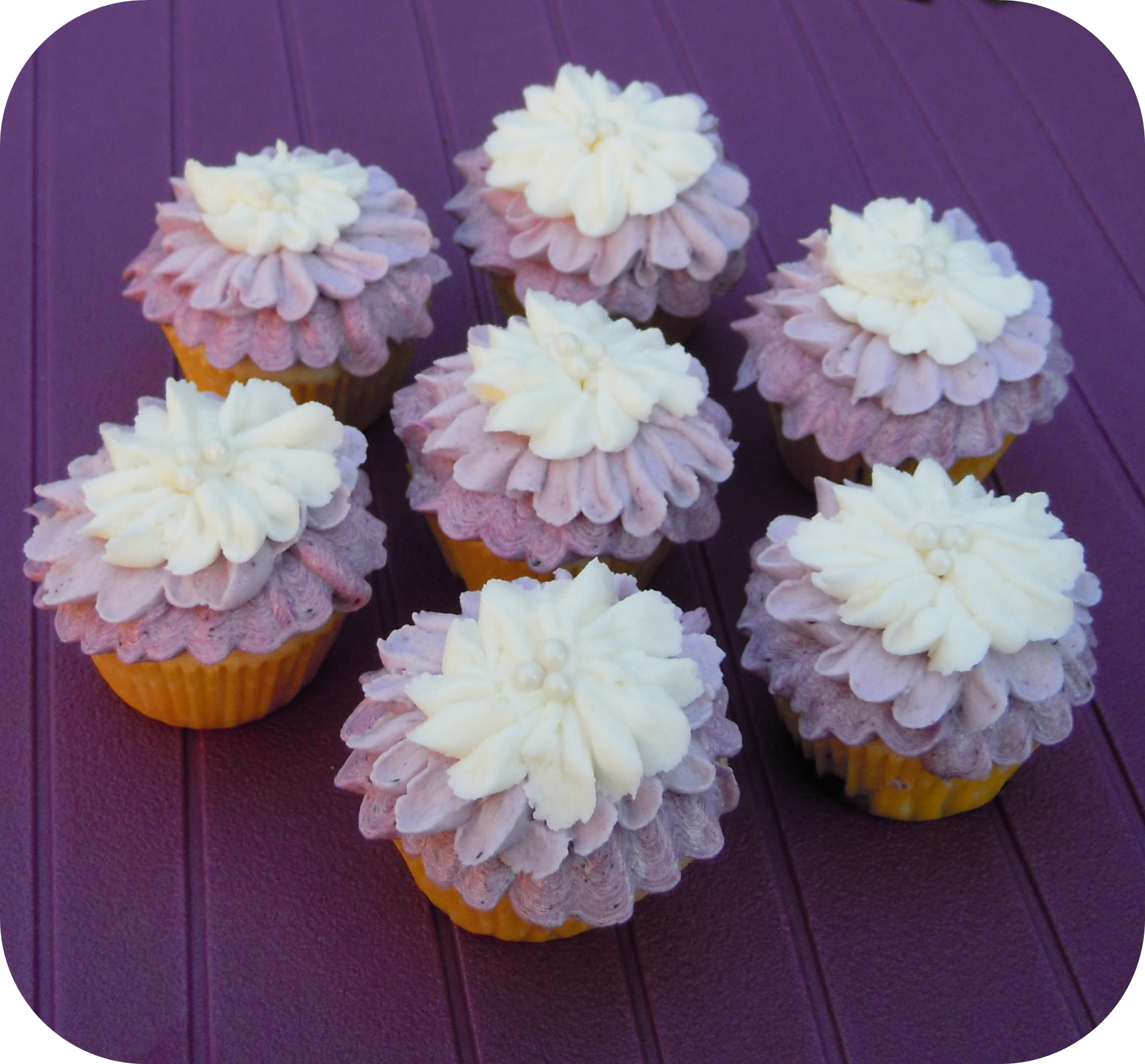 Mini Lemon-Blueberry Cupcakes with Blueberry Buttercream |